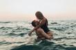 Leinwandbild Motiv lovely couple kissing in the sea