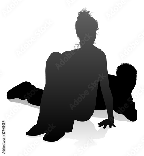 People silhouette of a young man and woman, probably a couple or husband and wif Canvas Print