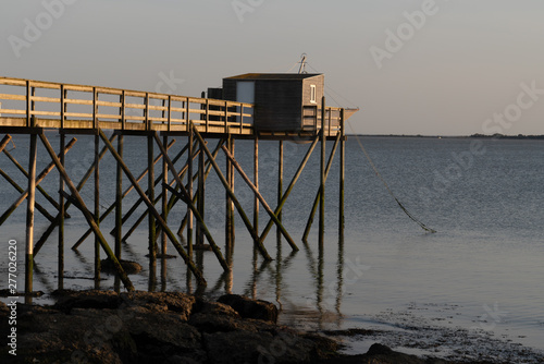 fishing huts on stilts at Fouras Aquitaine France at dusk Tablou Canvas