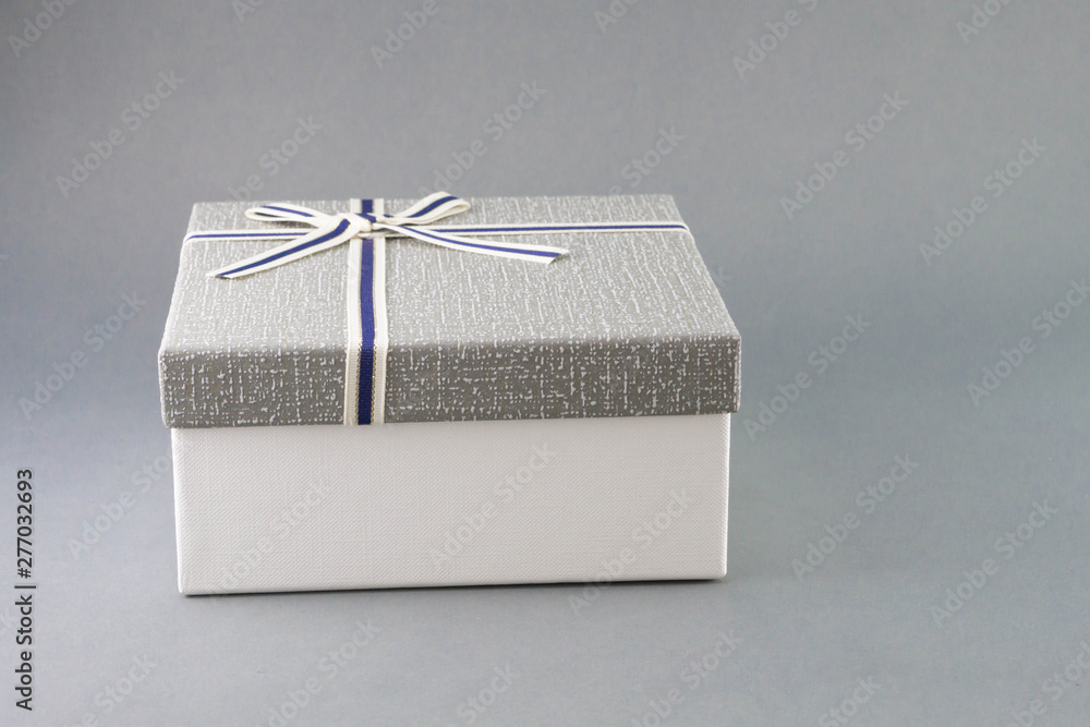 Fototapety, obrazy: Grey gift box with ribbon on grey background, copy space
