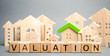 Leinwanddruck Bild - Wooden blocks with the word Valuation and many houses. Resale residential property condition. The study of the state of the house associated with the sale of housing. Property appraisal, value
