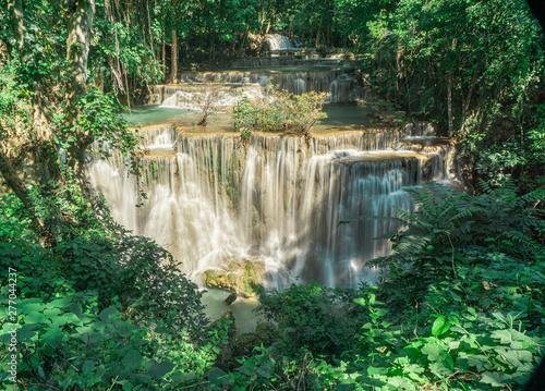 Fototapety, obrazy: Many waterfalls flow in the frame of plants and green trees. Huai Mae Kamin Waterfall Viewpoint, Kanchanaburi Province