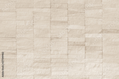 Photo  Rock stone tile wall texture rough patterned background in white cream color
