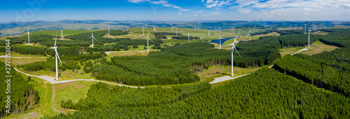Obraz Aerial drone panorama of turbines at a large onshore windfarm in Wales, UK - fototapety do salonu