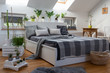 Modern bedroom interior of living room in white and grey colours with plants in scandinavian style.
