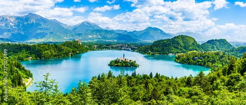 Beautiful landscape of Lake Bled the church island in the middle and the castle in the background of white clouded sky from Ojstrica viewpoint in Bled, Slovenia