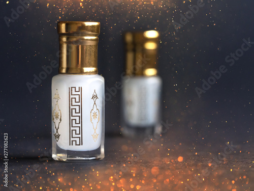 Obraz Concentrated perfume in a mini bottle on the black background - fototapety do salonu