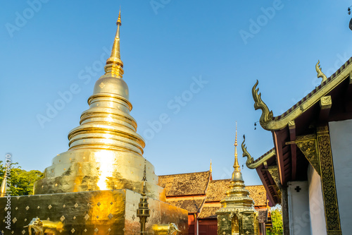 View of Wat Phra Singh with the golden pagoda, the popular historical landmark temple in Chiang Mai, Thailand