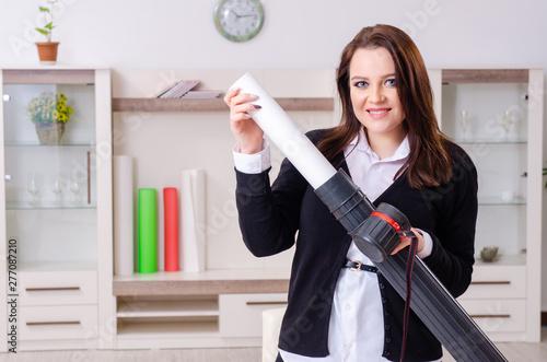 Fototapeta Female designer working in the office
