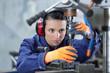 Leinwandbild Motiv professional serious woman working with an electric drill