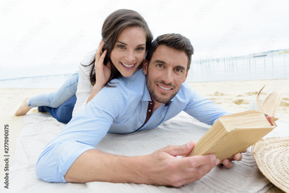 Fototapety, obrazy: happy lovers reading a book together