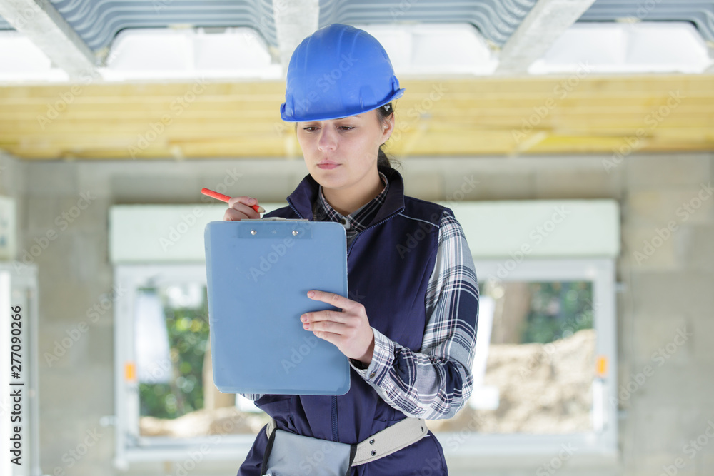 Fototapety, obrazy: portrait of serious construction female worker