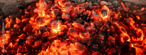 Cuadros en Lienzo Burning coals from a fire abstract background.