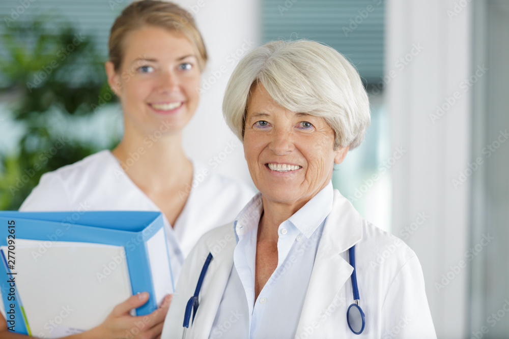 Fototapety, obrazy: portrait of doctor woman with stethoscope and nurse