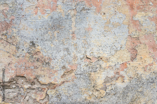Fotoposter Oude vuile getextureerde muur Textured grunge background. Old plastered wall with a multilayer cracked coating. Grunge texture with a deep pattern on whitewashed wall