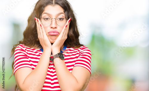 Young beautiful woman wearing glasses Tired hands covering