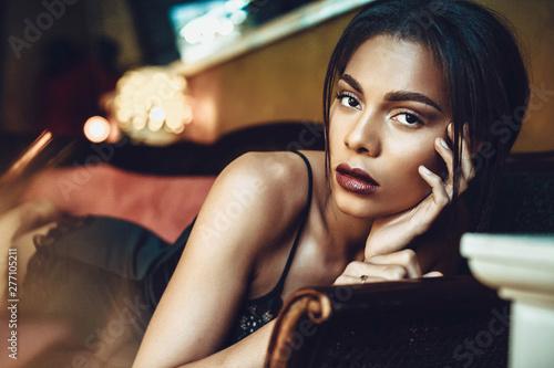 Beautiful dark-skinned young woman sensualy posing in black lingerie Wallpaper Mural