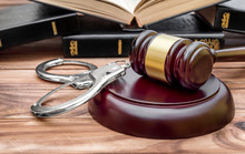 Gavel, Handcuffs And Books On The Table. Law And Justice Concept.
