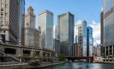 Chicago city skyscrapers on the river canal, blue sky background