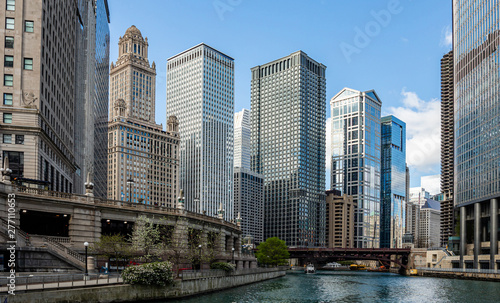 Chicago city skyscrapers on the river canal, blue sky background Wallpaper Mural