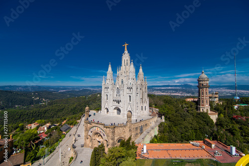 Foto op Canvas Barcelona Barcelona, Spain - April, 2019: Tibidabo Cathedral. Temple of the Sacred Heart of Jesus at Mount Tibidabo. Barcelona, Spain. Blue sky with cloud of spring day. Famous landmark in Catalonia.