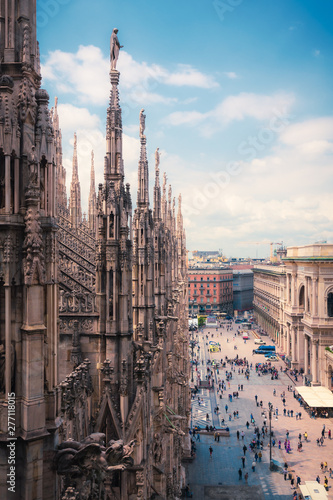 Garden Poster Milan View of people enjoying Piazza del Duomo with the ornate architecture of the Milan Cathedral Lombardy, Italy
