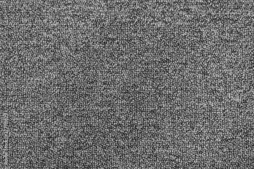Generic and seamless grey carpet background texture.