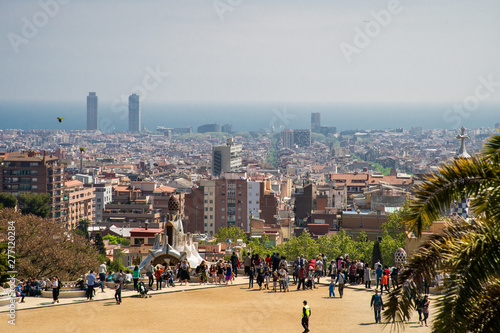 Foto auf Gartenposter Barcelona Barcelona, Spain - April, 2019: Park Guell Colorful Wide View of Buildings with Tourists with tourist view on Barcelona