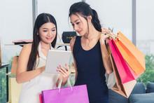 Two Asian Women Shopping At Re...
