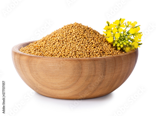 Photo mustard seeds in wooden bowl
