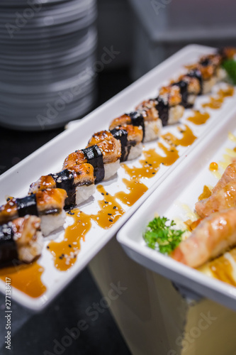 Aluminium Prints Buffet, Bar delicious sushi rolls set in a variety of japanese food