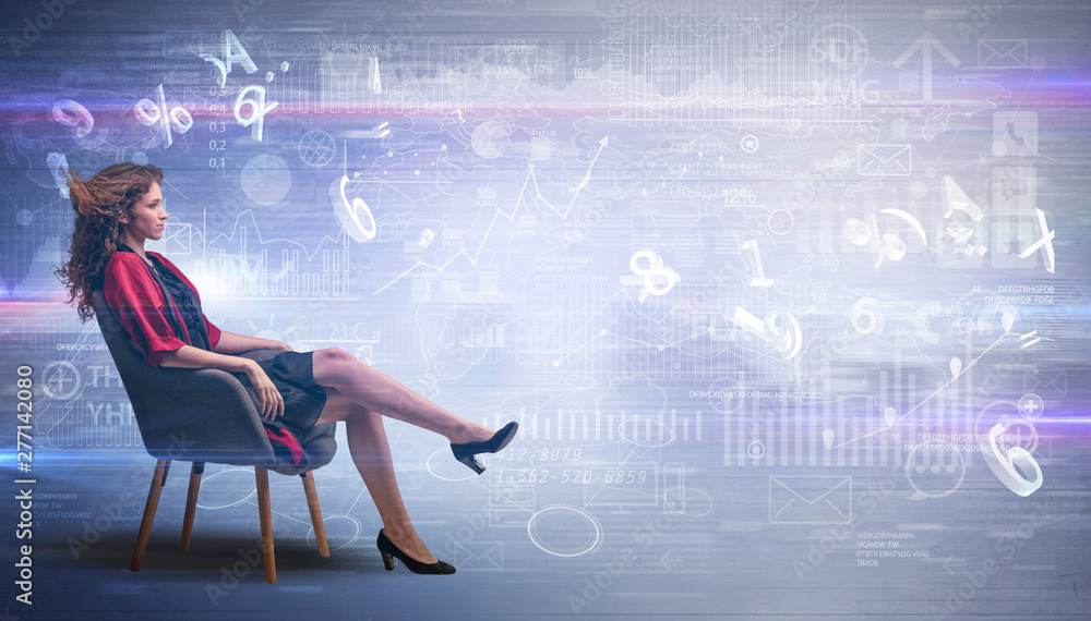 Fototapety, obrazy: Elegant woman sitting in a sofa with numbers and reports concept