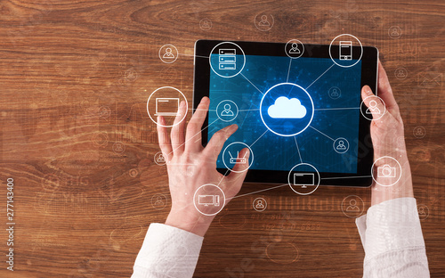 Deurstickers Europa Hand touching tablet with cloud computing and online storage concept
