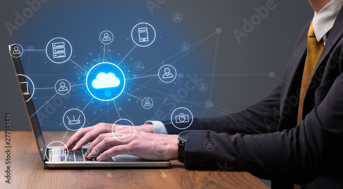 Fototapeta Businessman hand typing with cloud technology system and office symbol concept obraz