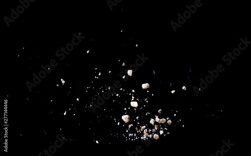 Fotografie, Obraz Break stone caused by explosion against black background