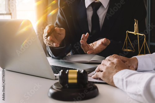 Fototapety, obrazy: Business and lawyers discussing contract papers with brass scale on desk in office. Law, legal services, advice,  justice and law concept .
