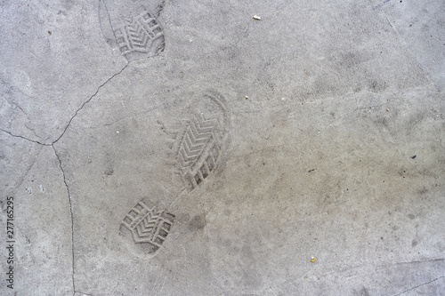 Vászonkép  traces of shoes on the concrete floor