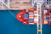 Large Container Ship Loads Cargo In Logistic Port With Crane. Concept Import Export Business. Aerial Top View