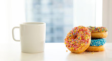 Doughnuts And Coffee Cup On Wh...