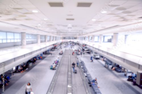 Fotografering  Airport concourse interior blurred travel background of people travelling for bu