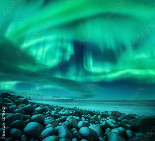 Cuadros en Lienzo Aurora borealis above the snow covered mountain hill in europe