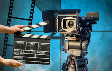 Clapperboard On Cinema Camera Background