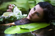 Beautiful Sexy Woman Bathes In A Lake With Water Lilies