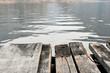 Wooden bridge for passenger boat landing in the reservoir