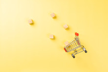 Shopping Cart Isolated On Yellow Background