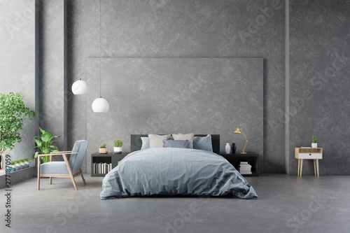 Blue dark armchair near cabinet and bed with sheets in bedroom interior concrete wall and modern furniture Canvas Print