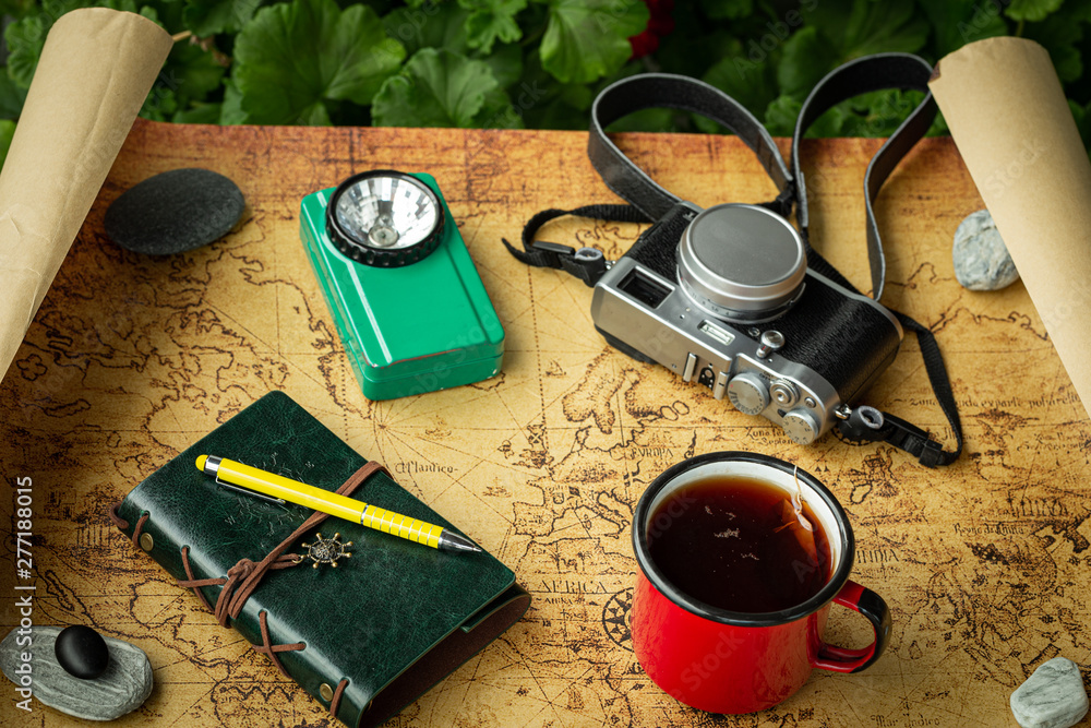 Fototapety, obrazy: Vacation trip with a map next to a cup of tea and travel equipment, retro style