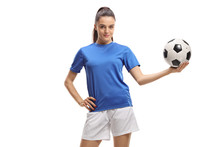 Young Woman Soccer Player Holding A Football