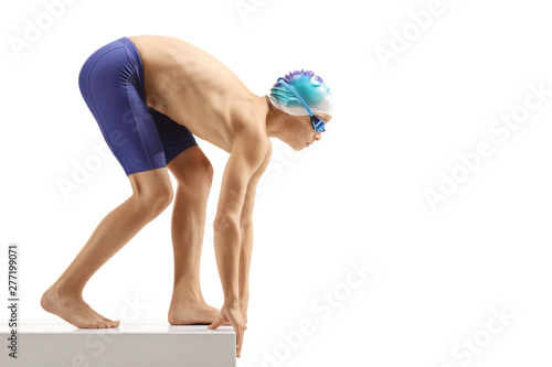 Young boy swimmer preparing for a swim Wallpaper Mural