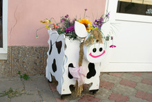 Unusual Flower Pot In The Form...